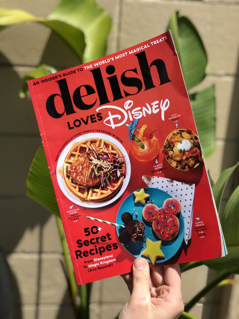 Red magazine with food dishes on the cover with green palms in the background