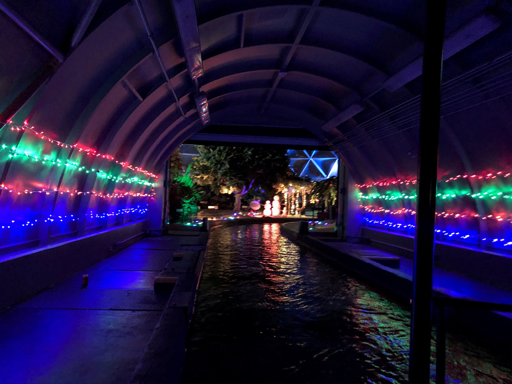 Boat on the water with colorful Christmas lights