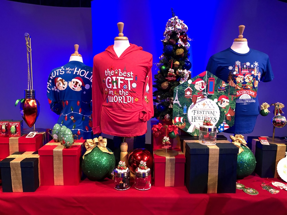 Blue and red shirts with green Christmas ornaments on a red table