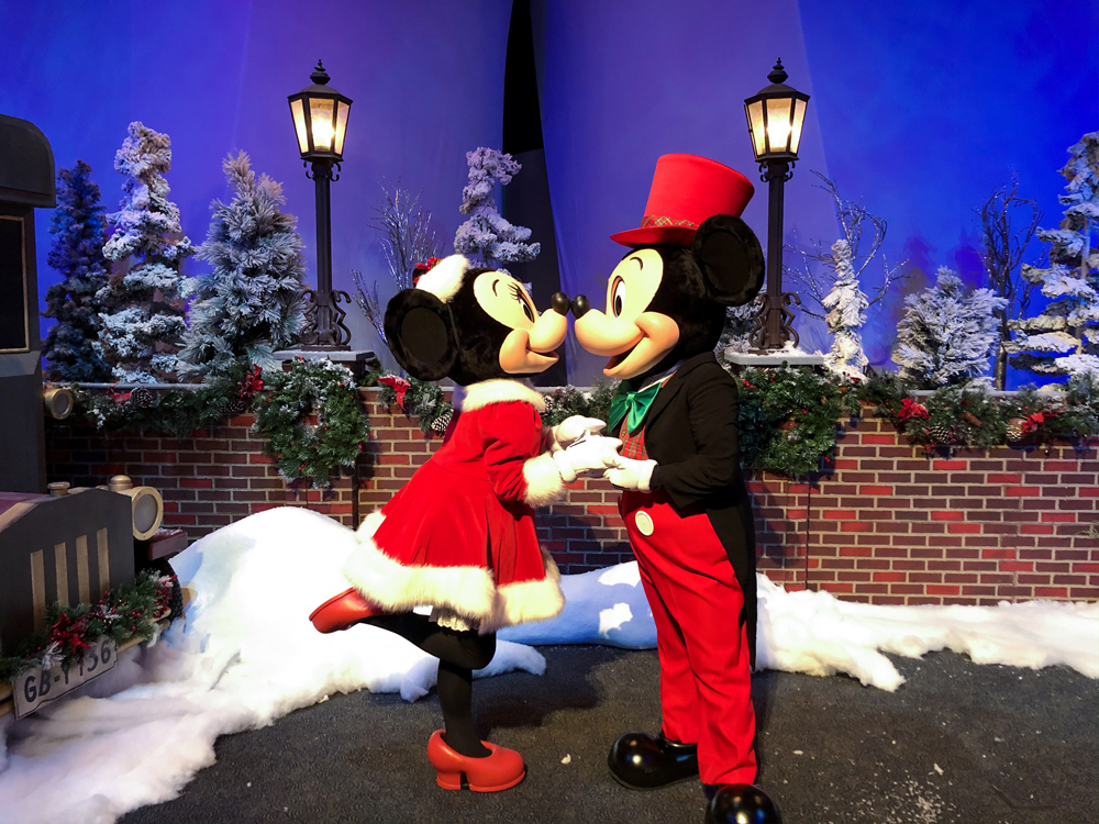 Mickey and Minnie Mouse in red and black Christmas outfits