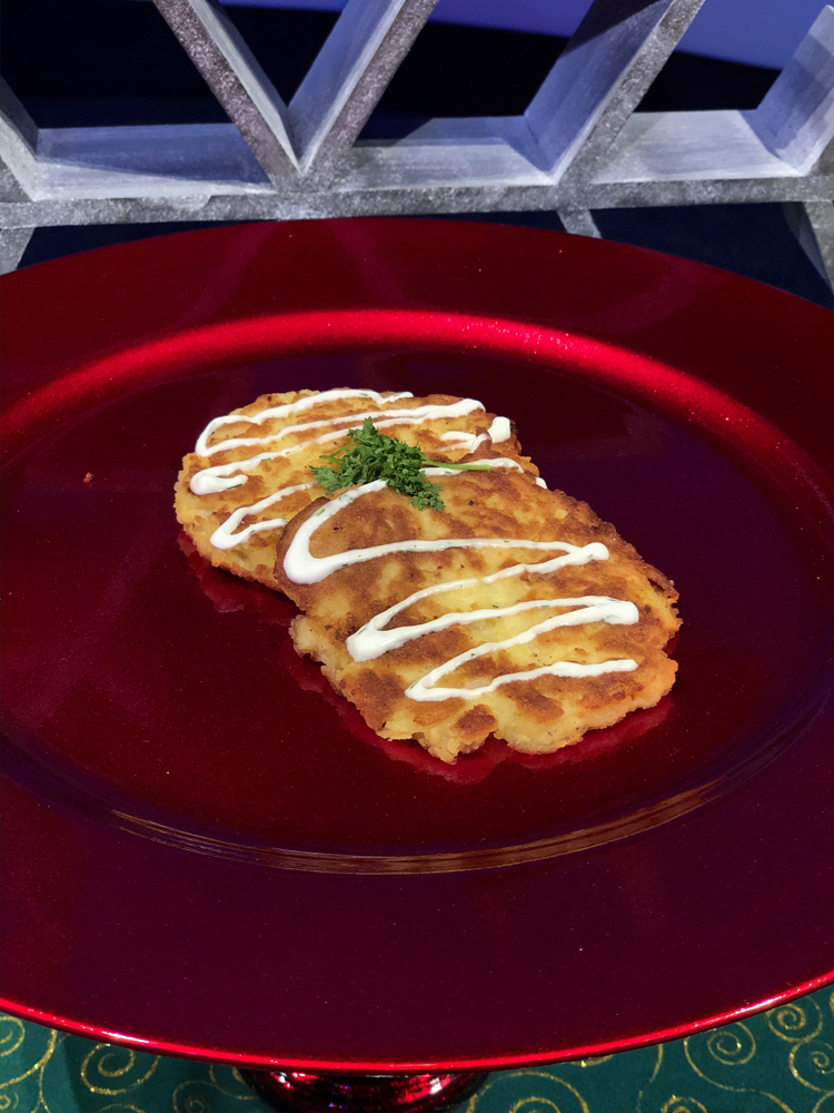 Brown potato latkes on a red plate